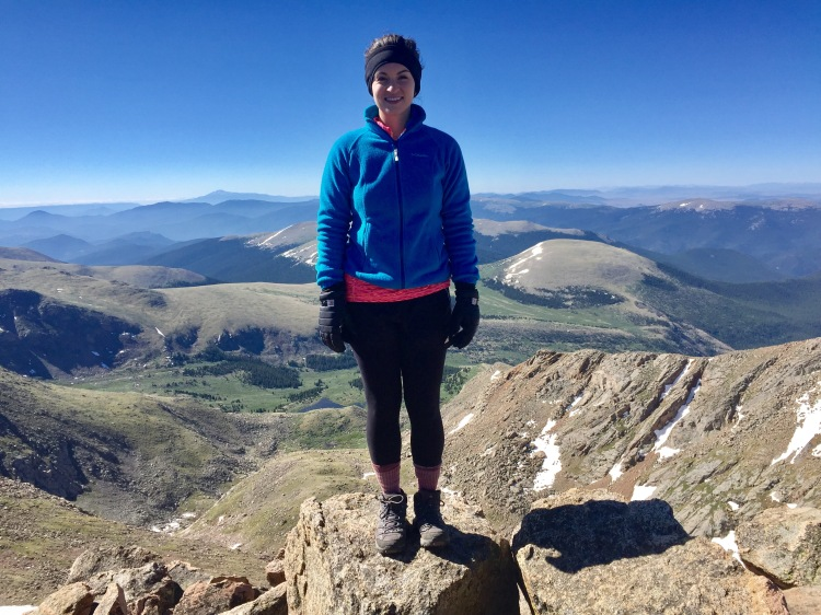 healthy woman hiked to top of mountain in fresh air